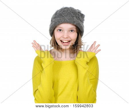 Portrait Of Laughing (happy) Teen Girl In A Knitted Hat And Bright Jersey..