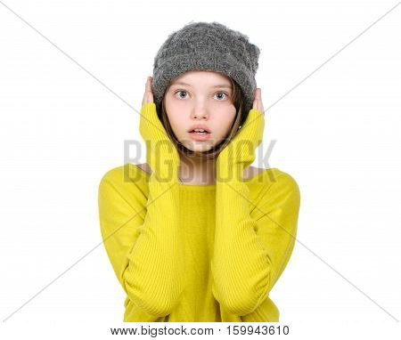 Portrait Of Surprised (frightened) Teen Girl In A Knitted Hat And Bright Jersey..