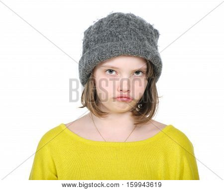 Portrait Of Resentful Teenager In Funny Hat Knitted Jumper And Bright..