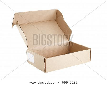 carton box with blank sticker label attached to the side isolated on white background, carton box for postal delivery open and empty