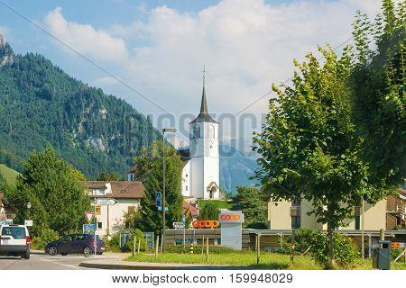Charmey Switzerland - August 22 2013: Church in Charmey village at Prealps mountains in Gruyere district Canton Fribourg Switzerland