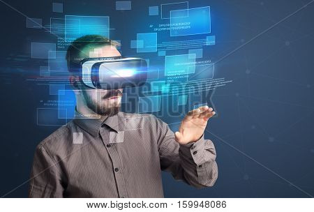 Amazed businessman with virtual reality data and blue squares in front of him