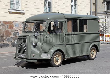 HELSINKI FINLAND - MAY 27 2016: Citroen H Van - light truck produced by the French car maker Citroen between 1947 and 1981. Green delivery van on Lonnrotinkatu stpeet Helsinki May 27 2016