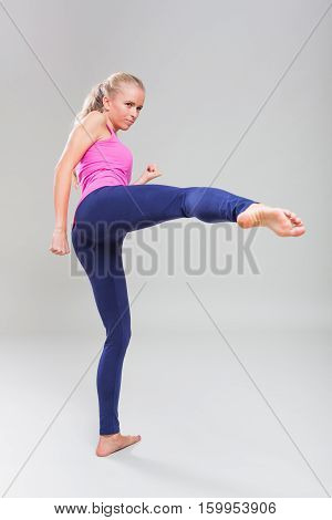 Studio shot portrait of young woman who is practicing kung fu.