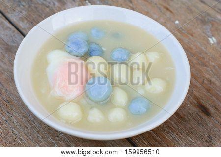 Dumplings in coconut cream (Bua Loi) on Thai silk Dessert of Thailand
