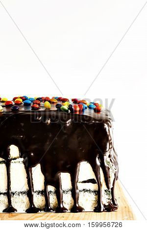 The Cake Watered Chocolate And Sprinkle With Colored Sprinkles Isolated