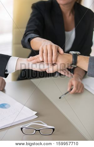 Close up of giving a high five, business contract, great and effective agreement, settled terms and conditions, payments, protect yourself as a business owner, mutual funds. Teamwork concept