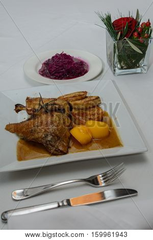 Crispy Martin goose with side dishes festlich at the table
