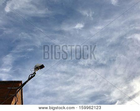 Security camera under winter sky