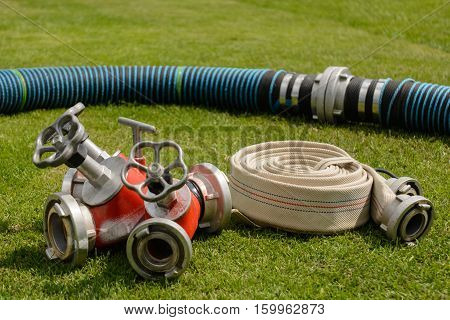 Rolled fire hose with coupling and distributor - close-up