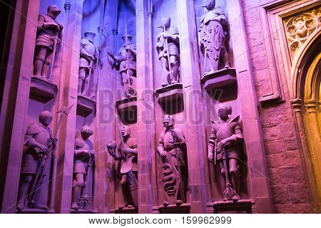 Leavesden, London, UK - 1 March 2016: Interior of the Great Hall of Hogwarts. Sculptures of wizards and knights