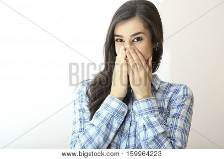 Shy girl in plaid shirt is smiling