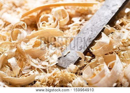 old chisel and wood shavings in a workshop