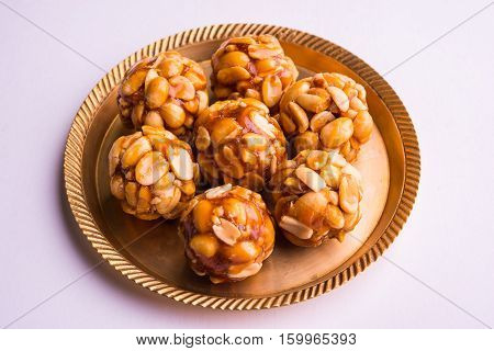 indian sweet groundnut ladoo or mungfali or peanut ladu made using roasted peanuts and jaggery