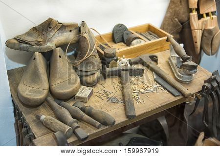 Old Shoemakers Tools On Top Of A Table
