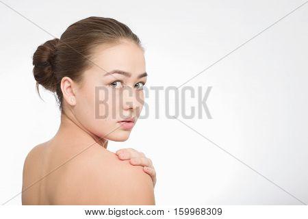 shocked scared girl looking back over shoulder on white background