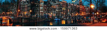Amsterdam Netherlands canals and bridges. Night view of Keizersgracht and famous touristic place in Amsterdam