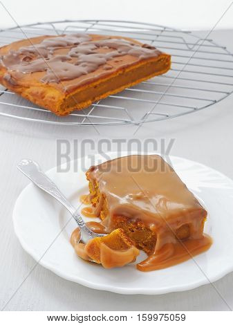 Piece of pumpkin sticky pudding with toffee caramel sauce