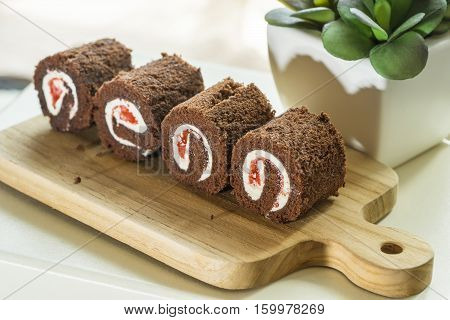 abstract black forest cake roll on wod block for menu - can use to display or montage on product