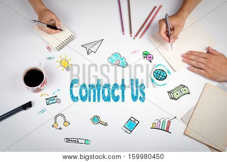 Contact Us Concept. The meeting at the white office table.