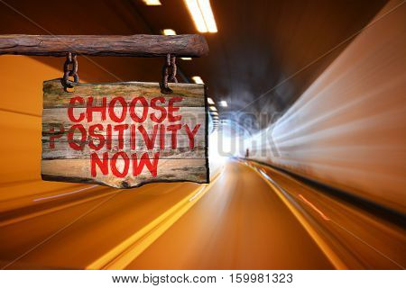Choose positivity now motivational phrase sign on old wood with blurred background