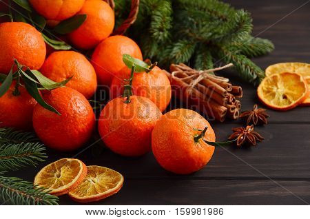 Fresh tangerine clementine with spices on dark wooden background, Christmas concept, selective focus, horizontal