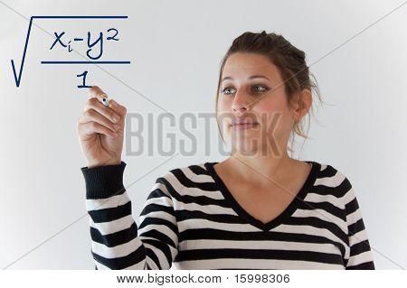 Student writes on glass whiteboard