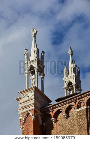Gothic pinnacles with medieval statues of Saints John and Paul basilica in Venice