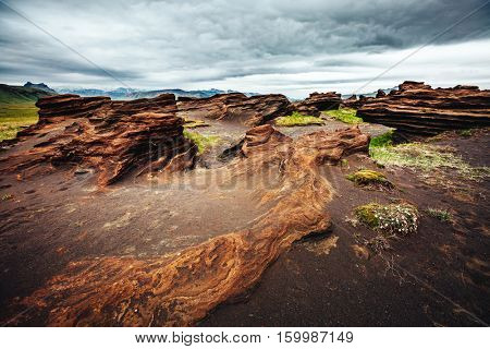Sandy rocks with by magma formed by winds. Popular tourist attraction. Unusual and gorgeous scene. Location Sudurland, cape Dyrholaey, south coast of Iceland, Europe. Artistic picture. Beauty world.