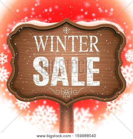 Vintage wooden signboard on snowy bacground with winer sale text
