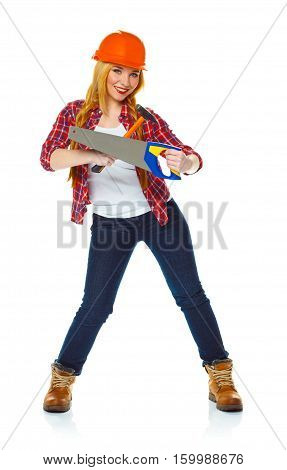 Young woman in helmet with a saw and hammer on a white background