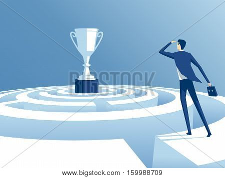 businessman has climbed to the top of the maze and trying to find the way to the cup worker looks how to get through the maze and get a prize. business concept the way to victory