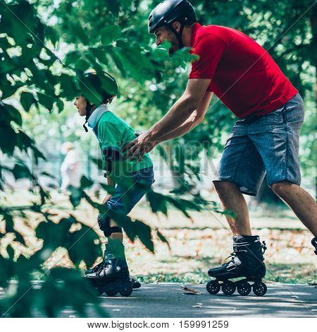 Father Teching Son Roller Skating