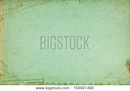 Green abstract book cover textured page with folds stains torn border and fading effect