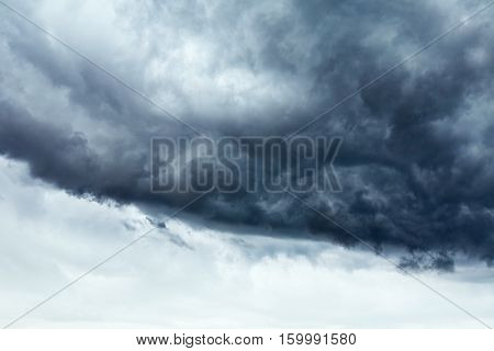 Stormy cloudscape background with clear sky part