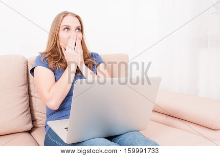 Female Making Gesture With Hand  Holding Laptop