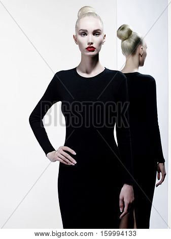 Fashion art studio portrait of elegant woman with red lips. Fashionable lipstick. Professional cosmetic. Portrait of beauty in black dress with big sexy lips. Very beautiful lips.