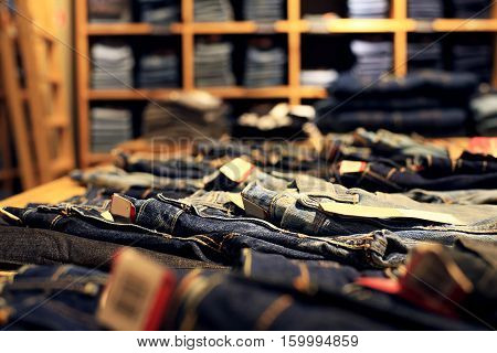 Denim clothes are laid out in a clothing store