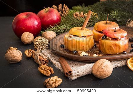 Baked Apples On Brown Plate With Holiday Christmas Decoration