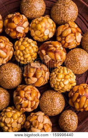 indian sweet til or sesame laddu, groundnut or peanut or mungfali ladoo and chana / daliya / futana /Roasted Chickpeas sweet Laddu, mixed laddu made using jaggery