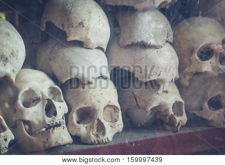 Uman skulls of victims of the Khmer Rouge memorial in Phnom Penh Cambodia.