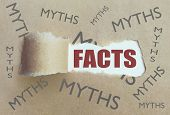 Torn brown paper revealing the word facts surrounded by myths poster