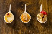 Entry entree and dessert of finger food in a spoon. Taste gastronomy finger food poster