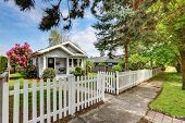 Cute craftsman home exterior with picket fence. Northwest USA poster