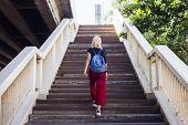 Woman Caucasian Traveler Tour Explore Stair Concept poster