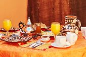 Delicious breakfast in Moroccan style served in riad (traditional Moroccan hotel) poster