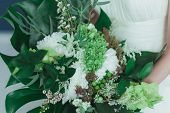 Wedding bridal bouquet with big tropical green leaves and white flowers. poster