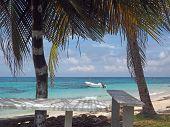 Big Corn Island Nicaragua fishing boat in Caribbean Sea Sally Peachie beach poster