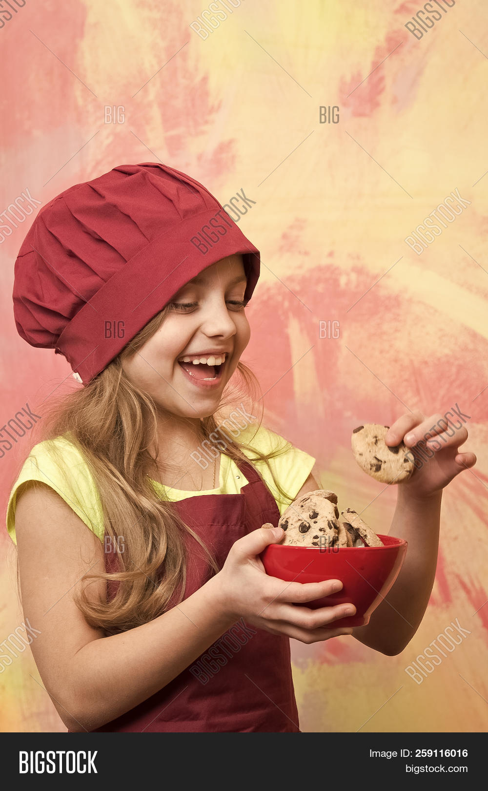 0f2b595799e Small Baby Girl Or Cute Child With Happy Face In Red Chef Hat And Cook Apron