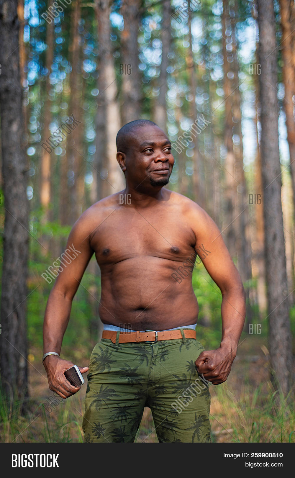Fat Black Guy With Big Belly Posing In The Woods